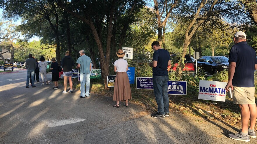Early voters line up in West Lake Hills, Texas, during the first hours of early voting on Wednesday.