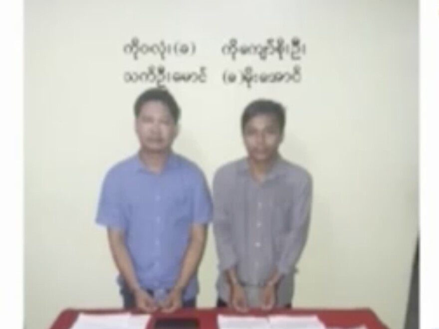Reuters reporters Wa Lone, left, and Kyaw Soe Oo stand handcuffed in an image released by the Myanmar Ministry of Information and broadcast by MRTV on Dec. 13.