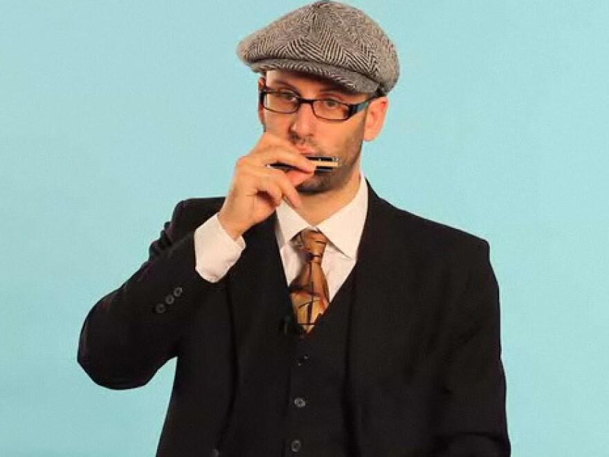 Marcus Milius makes harmonica instructional videos for Howcast.