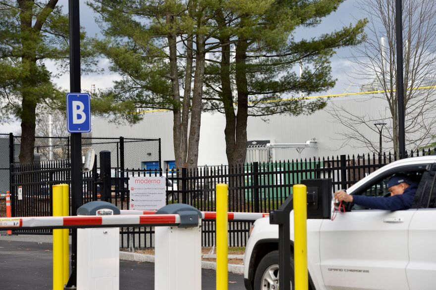 A worker passes through the security gate at the Moderna campus in Norwood, Mass., one of the sites where the biotechnology company is manufacturing its COVID-19 vaccine.