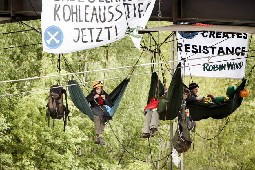 Activists from the environmental organization Robin Wood tied hammocks to a railway bridge on Sunday during a blockade of the coal mine company Vattenfall's Schwarze Pumpe power station near Spremberg, Germany.