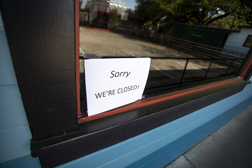 A business on South Congress displays a closed sign during the coronavirus pandemic.