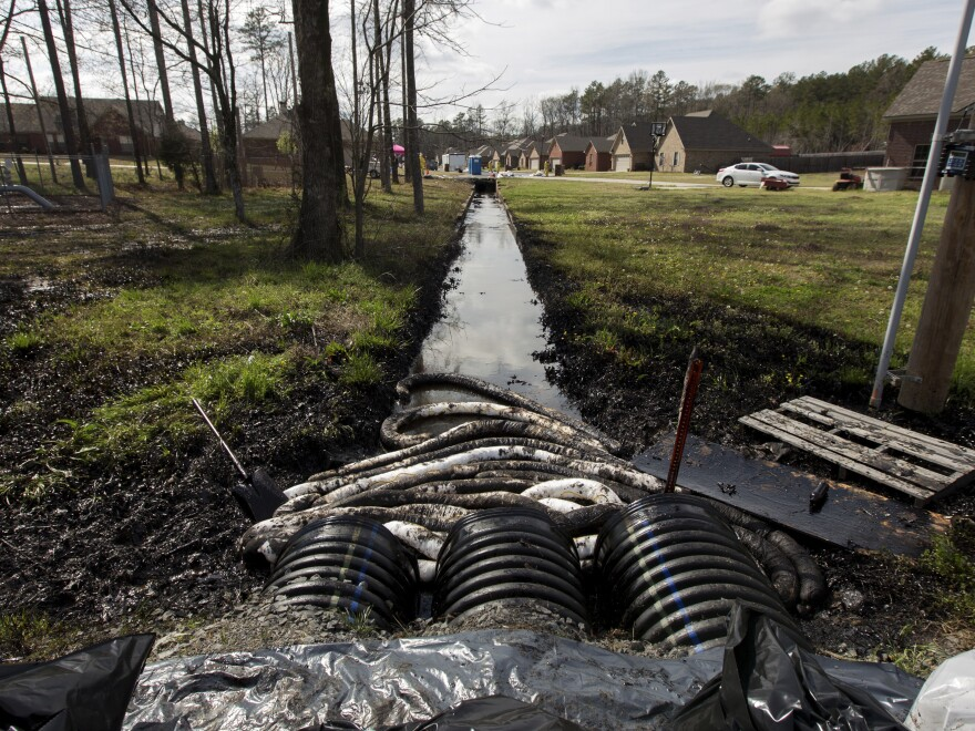 Spilled crude oil is seen in a drainage ditch near evacuated homes near Starlite Road in Mayflower, Ark., on March 31. An Exxon Mobil pipeline carrying Canadian crude oil was shut off after it ruptured March 29, causing an evacuation of 22 homes.