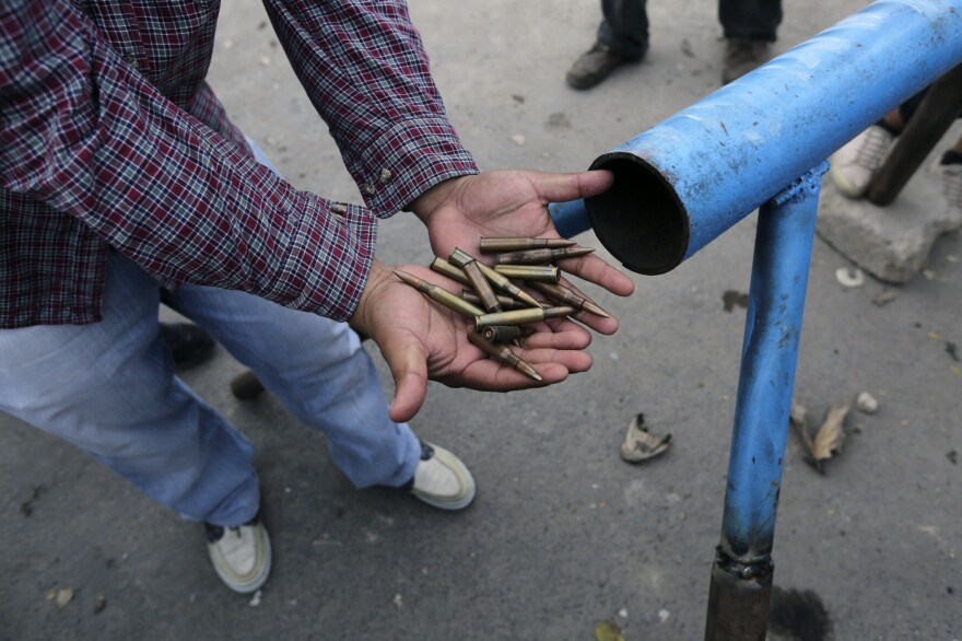 An anti-government demonstrator shows ammunition taken from the police during clashes in the Nicaraguan town of Las Maderas, near the capital city of Managua, on June 6, 2018.
