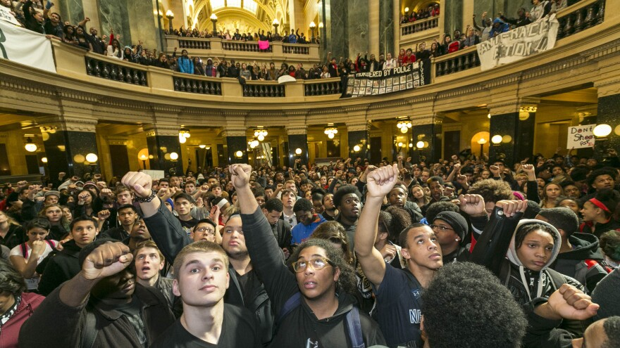 Protesters filled Wisconsin's state Capitol in Madison on Monday, demonstrating against last weekend's shooting death of Tony Robinson, an unarmed black man.