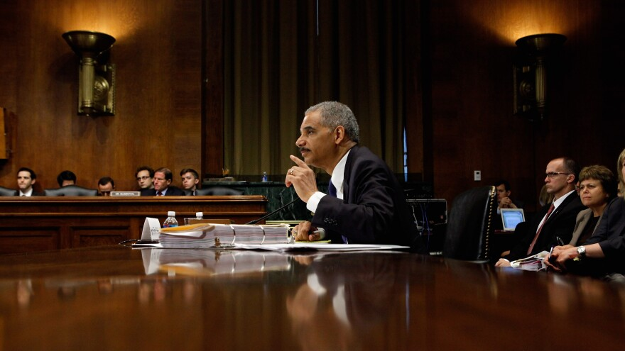 U.S. Attorney General Eric Holder answers questions in June 2012 while testifying before the Senate Judiciary Committee on Capitol Hill in Washington, DC. He faced questions about the ongoing Operation Fast and Furious investigation, his decision to order two federal prosecutors to begin criminal investigations into a series of national security leaks to the news media, and other subjects.