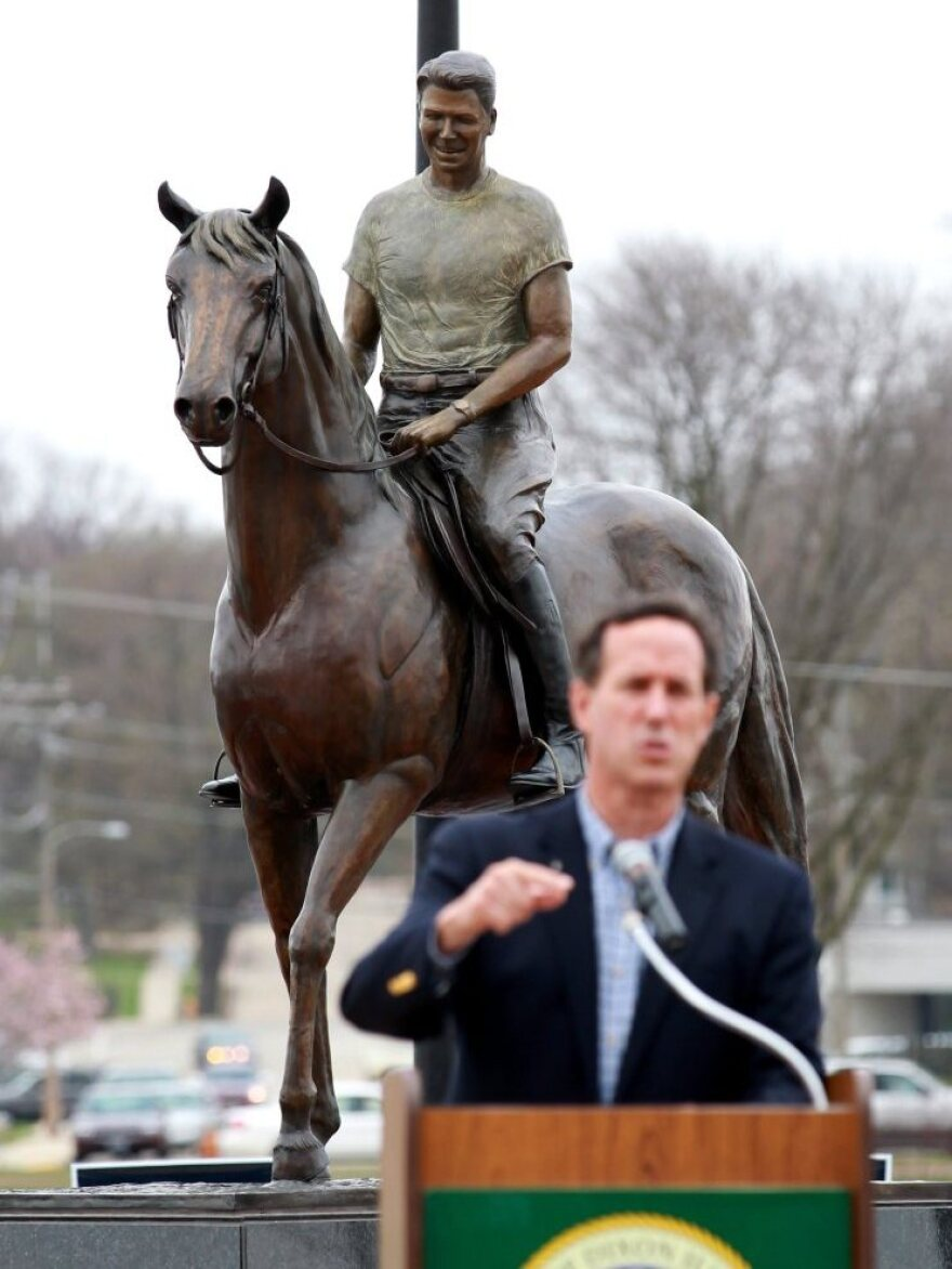 Rick Santorum speaks during a campaign stop in Dixon, Ill., on March 19. Is the party's obsession with Ronald Reagan overshadowing today's candidates?
