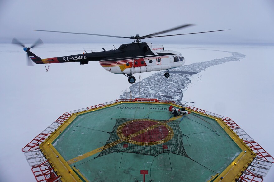 A helicopter takes off from the research vessel Akademik Federov to survey the thickness of an ice floe on Sept. 30.