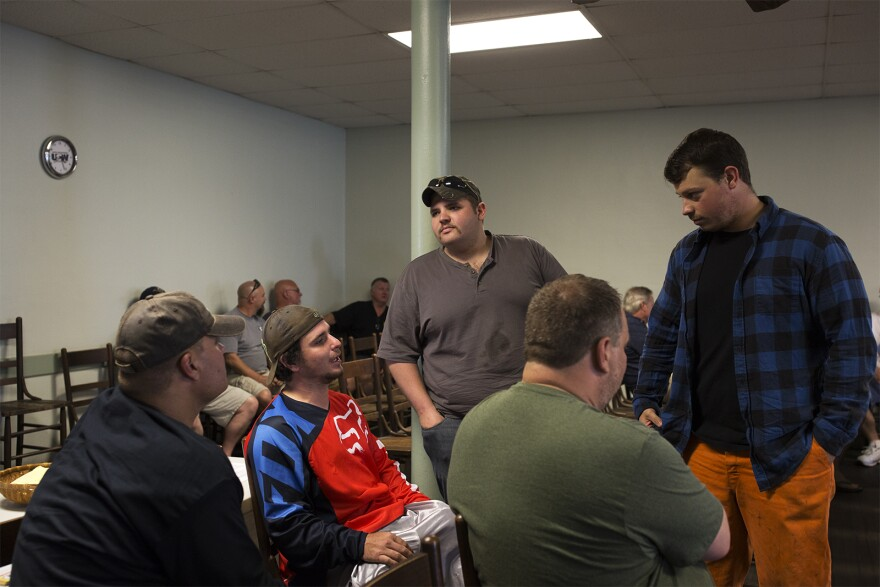 Local 1899 members talk before the start of a union meeting. May 2018