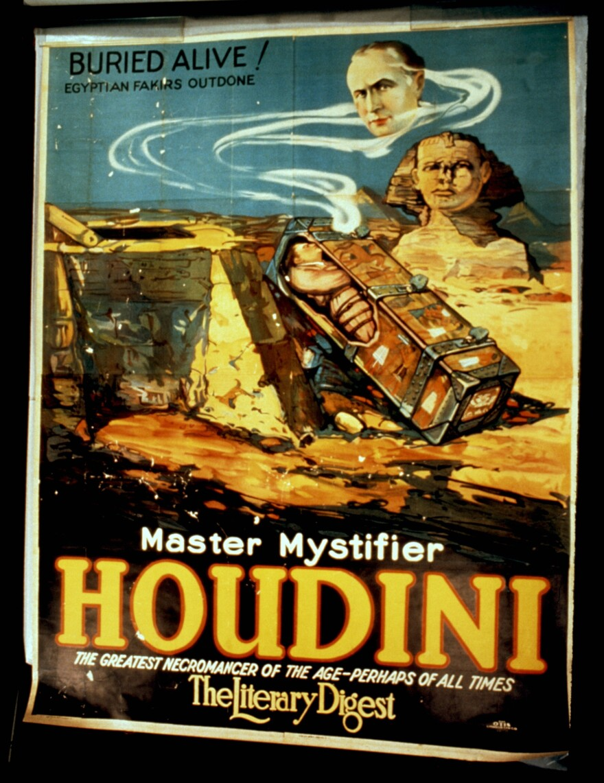 """After failing to dig his way out from under 6 feet of dirt, Harry Houdini went on to try <a href=""""http://www.wildabouthoudini.com/2011/01/digging-into-buried-alive.html"""">other, safer versions</a> of his """"Buried Alive"""" stunt — like this coffin stunt, featured on the cover of an old copy of <em>The Literary Digest</em>."""