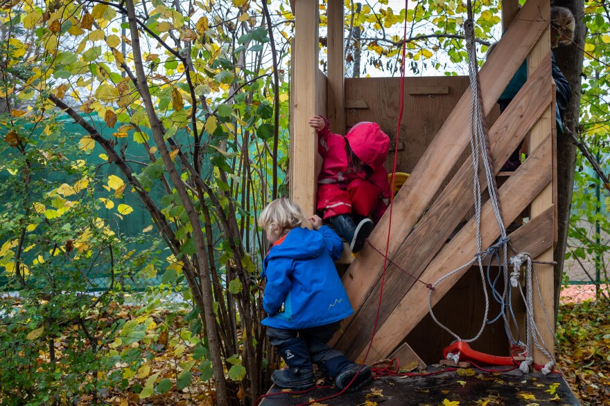Children climb and play on equipment at the Kallemach forest preschool in Munich, Germany, on Nov. 3, 2020.