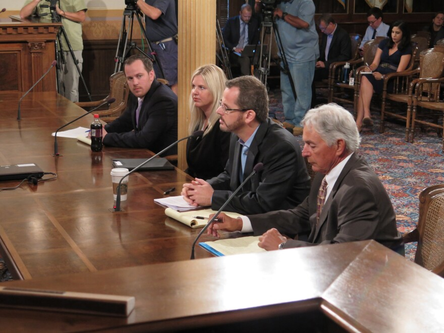 State Rep. Todd Courser (second from right), R-Lapeer, testifies before a House committee Wednesday in Lansing, Mich. Courser resigned amid a vote to expel him for an elaborate scheme to cover up an extramarital affair with a fellow lawmaker.