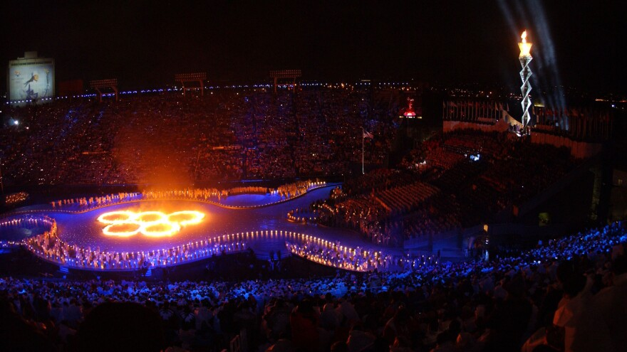The Olympic Flame burns during the Opening Ceremony of the 2002 Salt Lake City Winter Olympics at Rice-Eccles Stadium.
