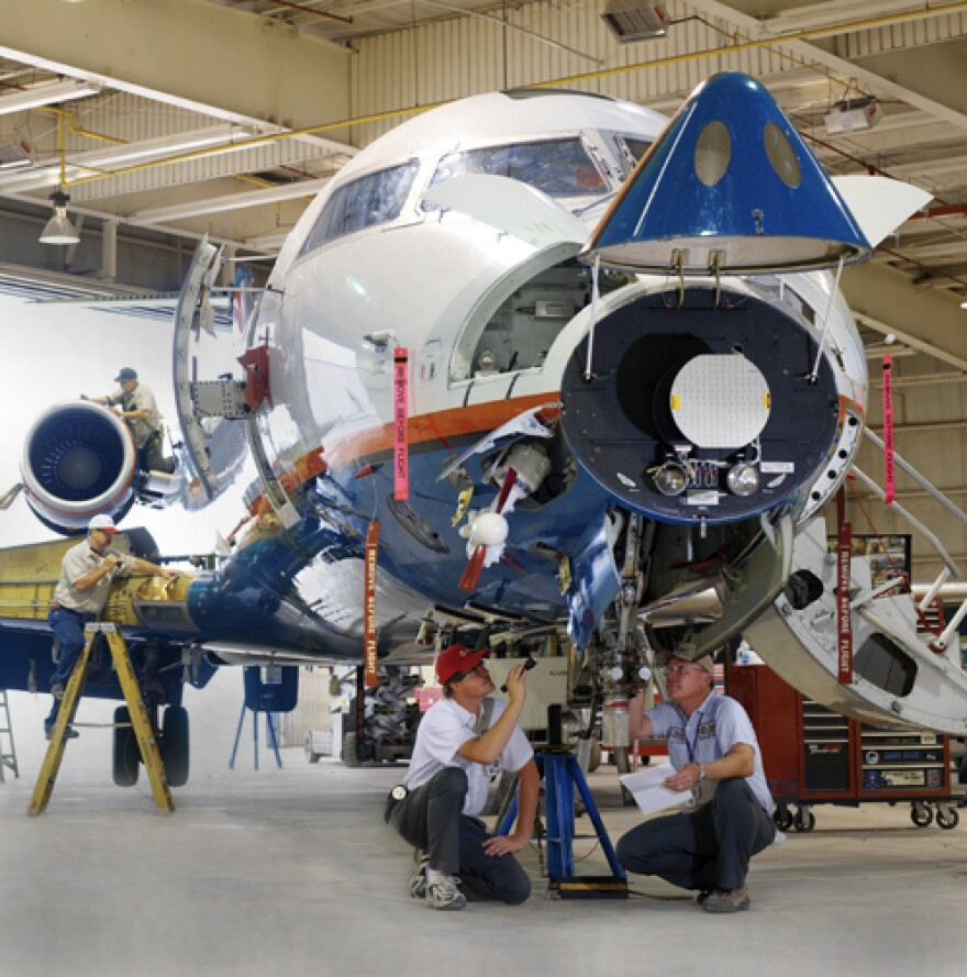 Mechanics work on a plane at AAR Aircraft Services Corp, in Oklahoma City, a few minutes away from Will Rogers World Airport. The company says it has at least 600 open jobs.