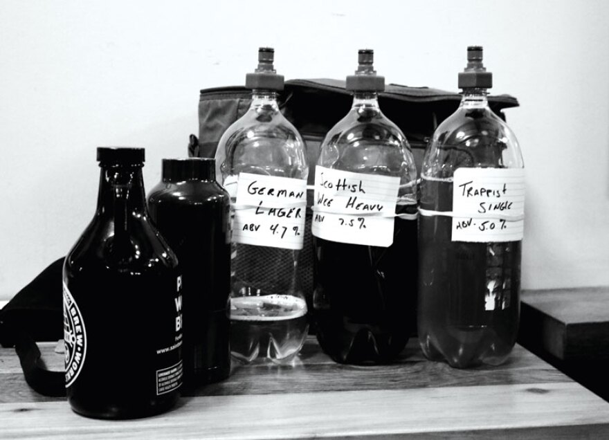 Bottles of homebrews at an STL Hops meeting.