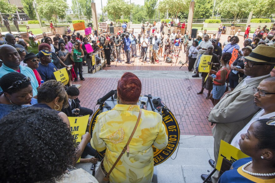 Louisiana state Rep. Patricia Haynes Smith speaks during a rally at City Hall on Friday in Baton Rouge, La. The local NAACP is calling for a boycott of Walmart and two local shopping malls.
