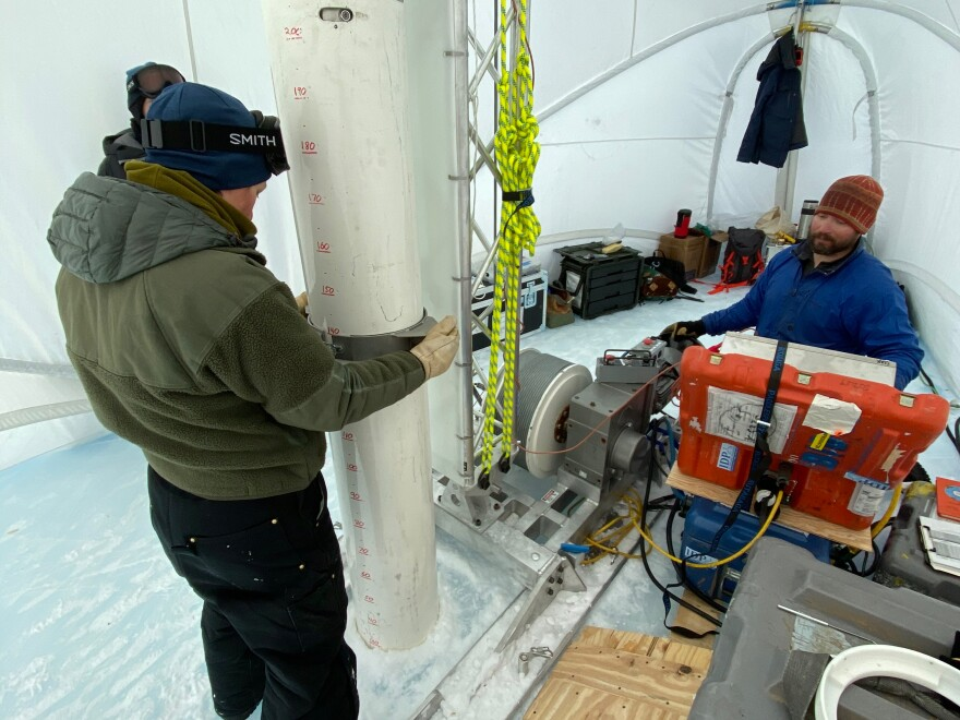 Drilling in progress. Graduate student Jenna Epifanio keeps the drill barrel straight while driller Tanner Kuhl lowers it into the hole. The 2019-2020 expedition focused on recovering large volume samples of the 2+ million year ice discovered in 2015-2016. Allan Hills, Antarctica, 2019.