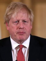 British Prime Minister Boris Johnson, seen on March 22, tested positive for the coronavirus 10 days ago. He's been admitted to a hospital for testing.