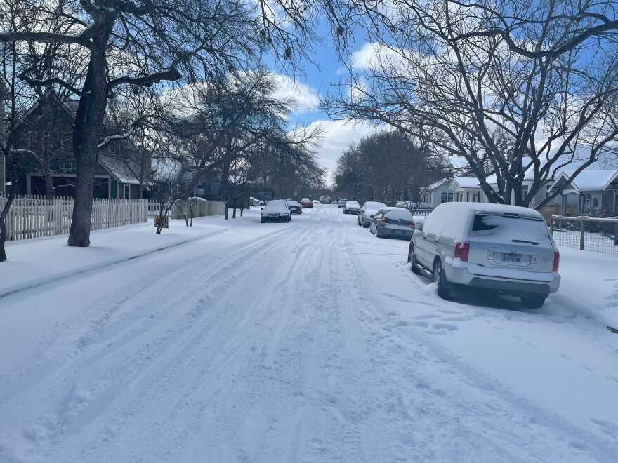A snow-covered street in Austin's Hyde Park neighborhood.