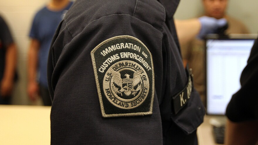 Immigration and Customs Enforcement officers process immigrants at a detention center in Phoenix.