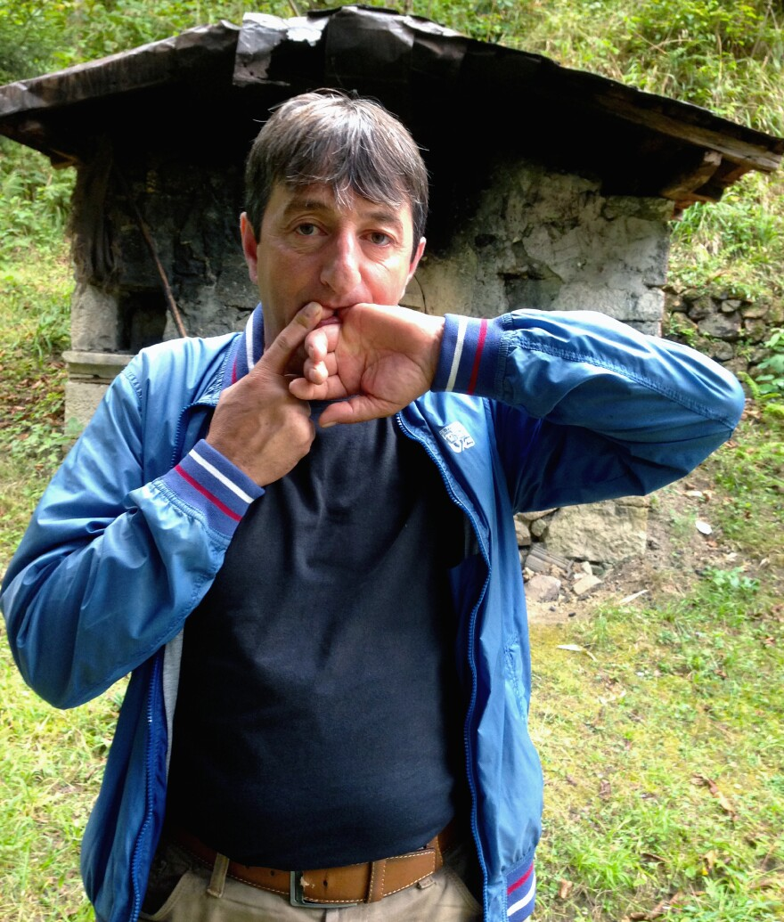 Halil Cindik, head of the Kuskoy Bird Language Association, demonstrates his technique for whistling Turkish words and phrases. The piercing tones can be heard a mile or more away, depending on conditions. Cindik says an annual festival is helping to keep the whistled language alive, but the spread of cellphones is causing villagers to abandon it.
