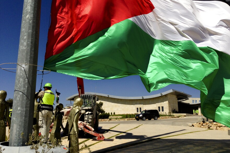 Palestinian flags at the top of Rawabi, where residents are planning to move in shortly.
