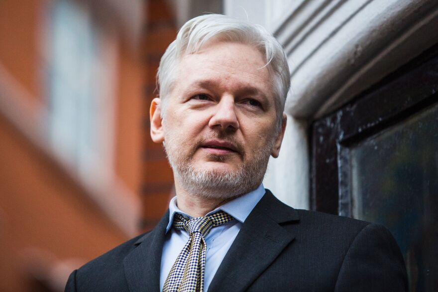 WikiLeaks founder Julian Assange addresses the media from the Ecuadorian embassy in central London in February.