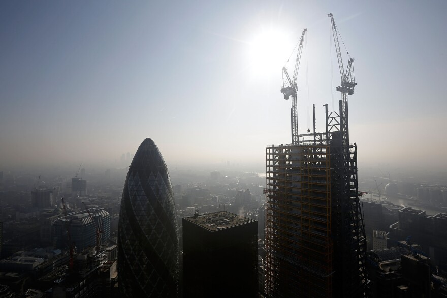 """London's 122 Leadenhall Street (nicknamed the """"Cheese-Grater"""") is shown under construction on March 5. Once complete it will be London's second-tallest building. The recent construction of numerous skyscrapers has sparked concern that views of historic landmark buildings, such as St Paul's Cathedral, are being obscured."""