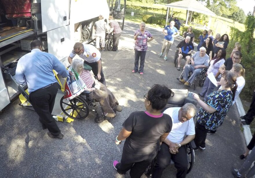 Staff at the Westwood Nursing and Rehabilitation Center in Fort Walton Beach, Fla., and firefighters, load Hurricane Irma evacuees onto a bus on Wednesday, Sept. 13, 2017.