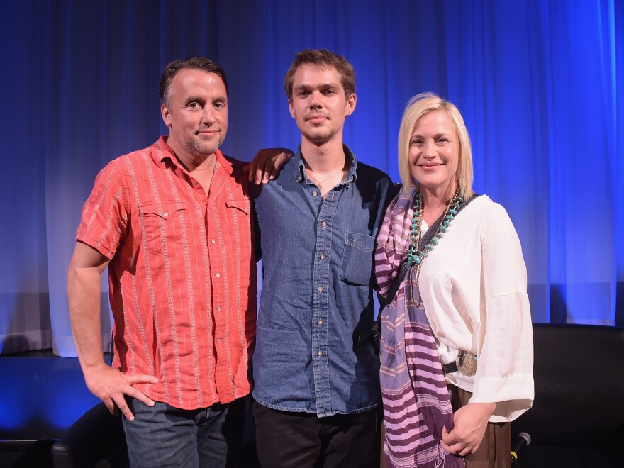 Ellar Coltrane (center) with Richard Linklater and Patricia Arquette, who plays his mother in <em>Boyhood</em>.