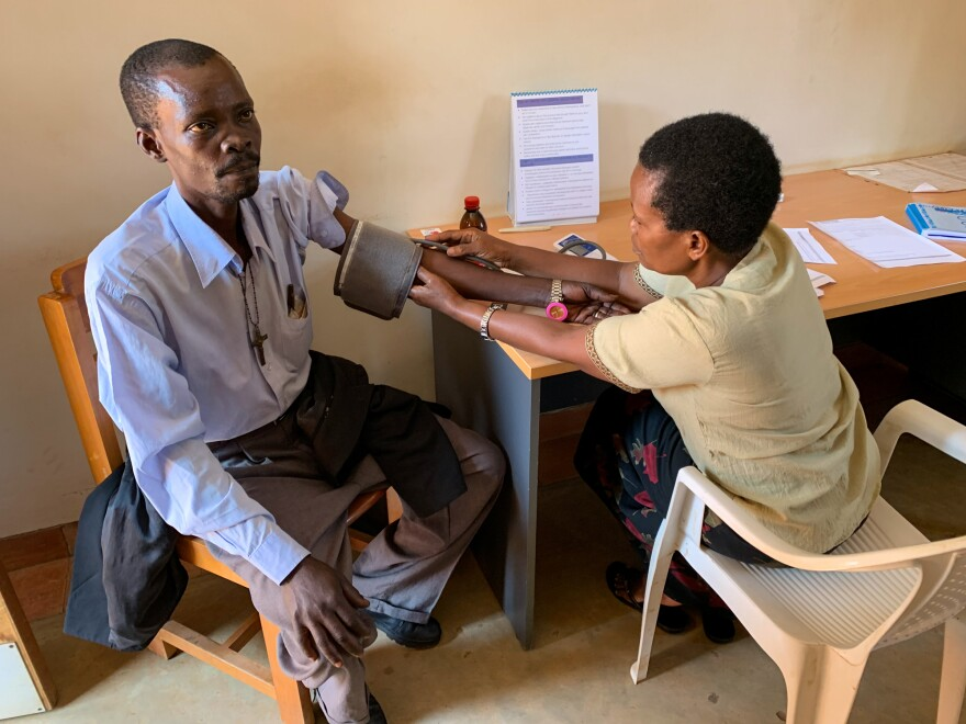 Noah Nsonzi gets a checkup at Hospice Africa. Nsonzi has pancreatitis. Nurses have prescribed liquid morphine to deal with resulting pain. The founder of the organization, Anne Merriman (not pictured), was a driving force behind Uganda's system for using liquid morphine.