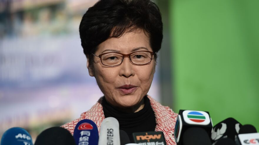 "Hong Kong Chief Executive Carrie Lam addresses the media after casting her vote during Sunday's district council elections. After results showed a landslide victory for pro-democracy candidates, Lam said she would listen ""humbly"" to the will of the voters."
