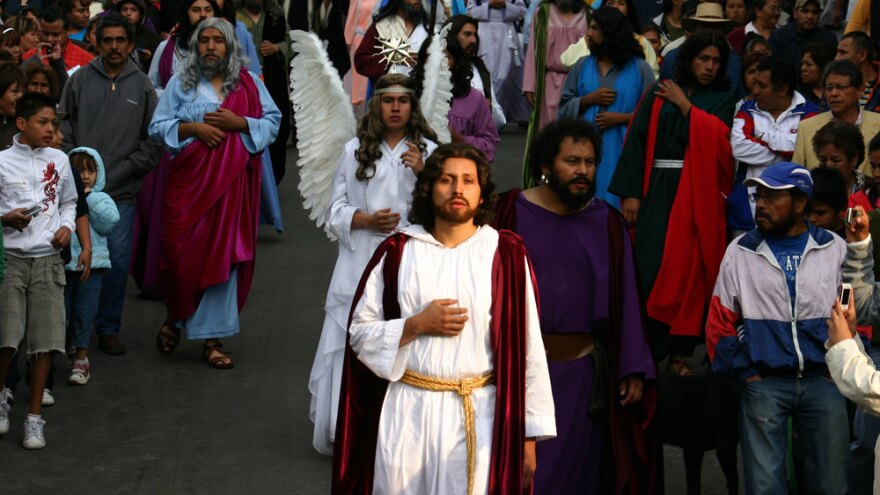 Gilberto Morales Pedraza, 20, as Jesus Christ, leads the disciples through the streets of the Mexico City neighborhood of Ixtapalapa. This is the 168th year that residents of this neighborhood have re-enacted Christ's final days in Jerusalem, his crucifixion and his resurrection.