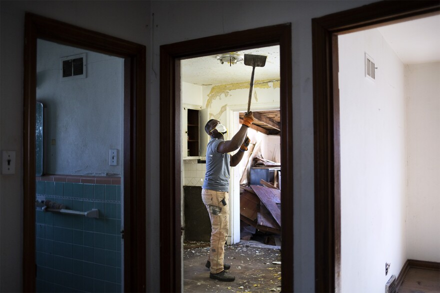 Eltoreon Hawkins works on restoring a vacant house in the Walnut Park West neighborhood of St. Louis.