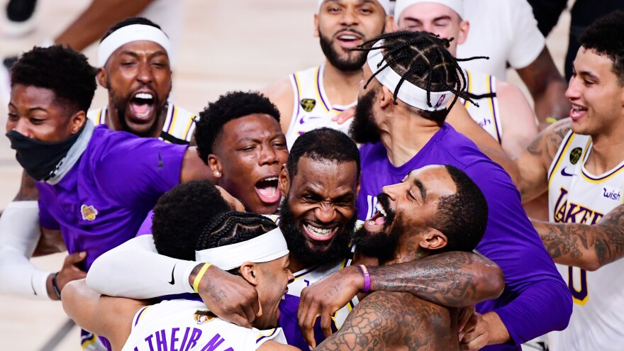 The Los Angeles Lakers celebrate after winning the 2020 NBA Championship in Game Six on Sunday in Lake Buena Vista, Fla.