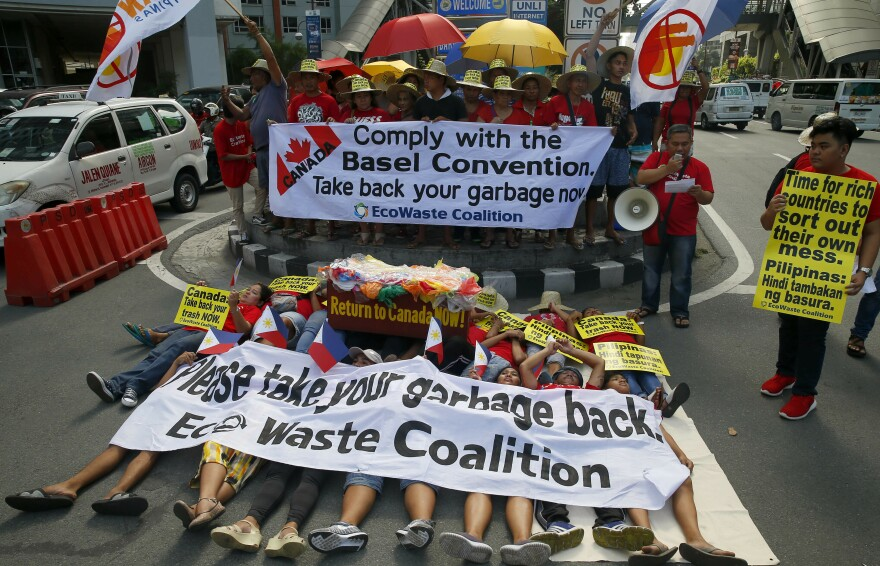 Environmentalists staged a mock die-in protest earlier this month outside the Canadian Embassy in Manila to demand the Canadian government speed up the removal of its garbage.