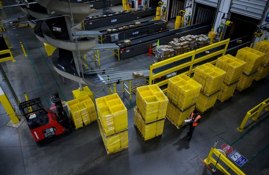 A man works at a distribution station at the Amazon fulfillment center in Staten Island, New York.