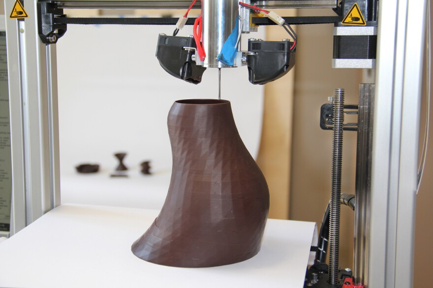 For 3-D food printers, chocolate is a good material to start with, because it's fairly simple to make it liquid inside the printer cartridge and solid once it drops out.