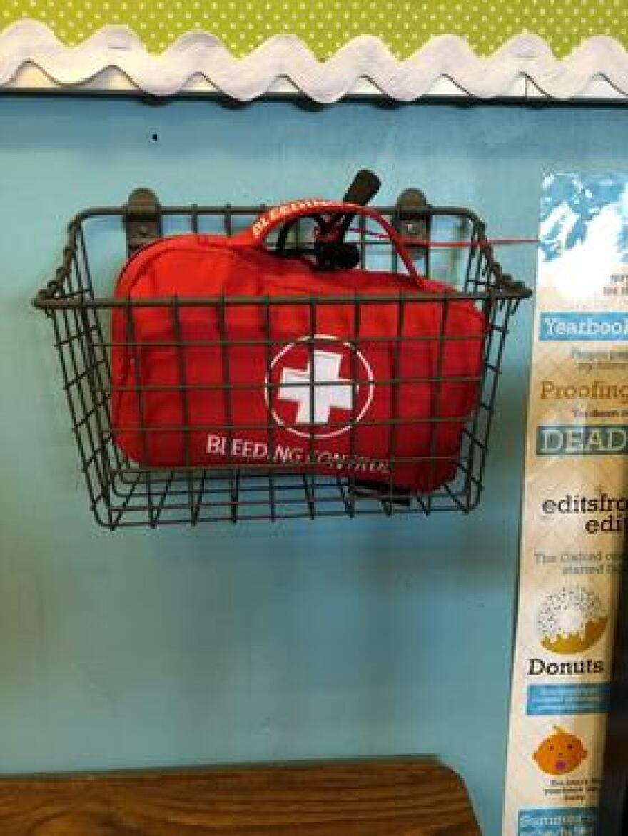 Shown here is a bleeding-control kit in a metal basket on the wall of a classroom at Marjory Stoneman Douglas High School. There's now one in each classroom.