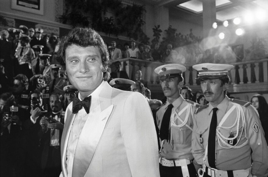 """French singer Johnny Hallyday arrives at the Cannes Film Festival in Cannes, France in 1976. Hallyday was known as the """"French Elvis."""""""