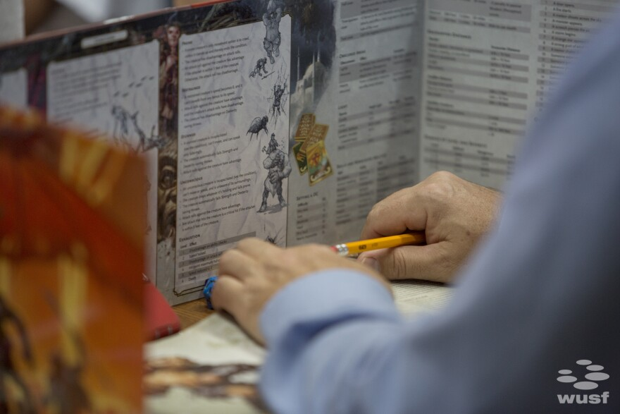 The DM rolls dice and makes notes behind a screen so that the outcomes of battles and quests is secret until he chooses to reveal them.