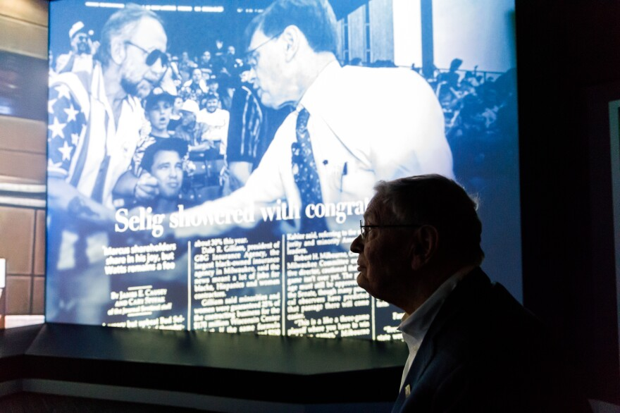 """Selig watches a presentation of the """"Selig Experience"""" at Miller Park. It's a multimedia presentation that tells the story of Selig's role in bringing Major League Baseball back to Milwaukee in 1970, and leading the effort 25 years later to build the new park."""