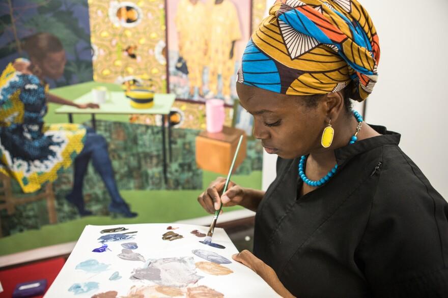 Njideka Akunyili Crosby paints in her Los Angeles studio in September 2017.