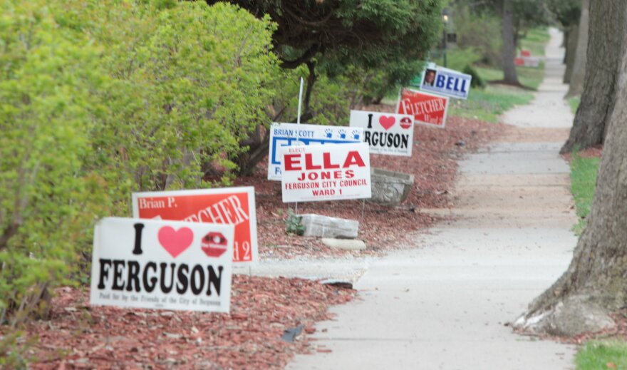 Yard signs for Ferguson City Council candidates sit outside of a home on April 6.