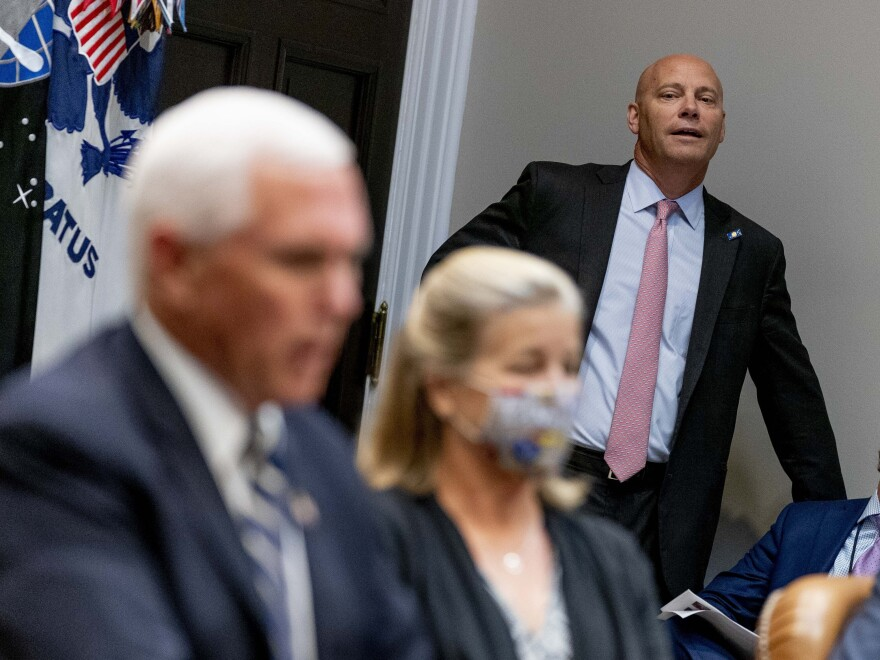 Marc Short, the chief of staff to the vice president, listens to Pence speak during a White House event in September. Short is the latest aide to test positive for the coronavirus.