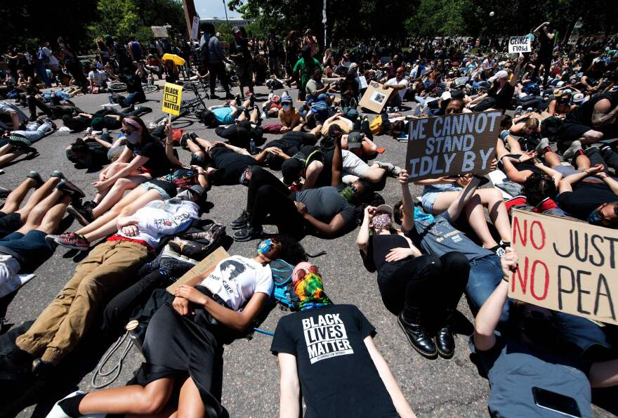 Demonstrators lie on the ground while yelling I can't breathe for nine minutes during a protest of the death of George Floyd in Denver on May 30, 2020.