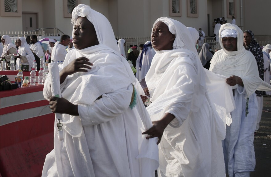 Muslim pilgrims make their way to Mount Arafat during the annual hajj pilgrimage.