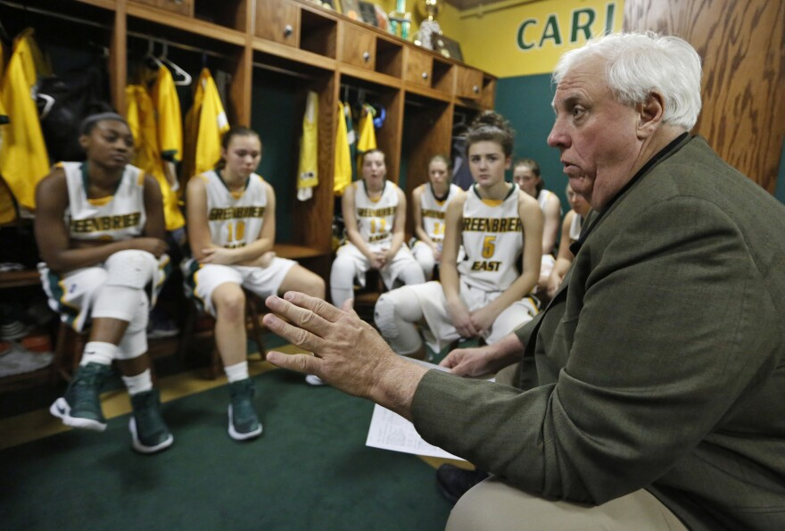 In this Tuesday, Dec. 13, 2016 photo, West Virginia Gov. -elect Jim Justice talks to his team during halftime of a girls high school basketball game in Lewisburg, W.Va.