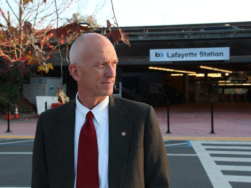 Steven Falk, former city manager of Lafayette, Calif., outside the city's Bay Area Rapid Transit station.