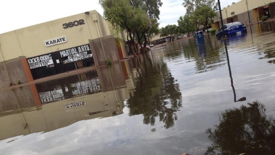 A parking lot at 35th Avenue and Thomas Street in Phoenix turned into a lake after Monday's storm.
